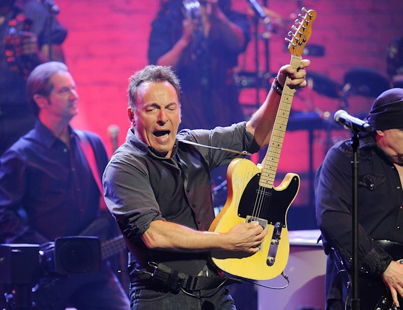 FILE - In this March 9, 2012 file photo, Bruce Springsteen, center, and the E Street Band perform at the Apollo Theater in New York. Springsteen has kicked off his Australian tour with a warning about his political influence over national economics. Springsteen and his E Street Band opened their Wrecking Ball Tour on Thursday, March 14, 2013 to enthusiastic reviews in Brisbane, the hometown of Australian Deputy Prime Minister and Treasurer Wayne Swan. (AP Photo/Evan Agostini, File)