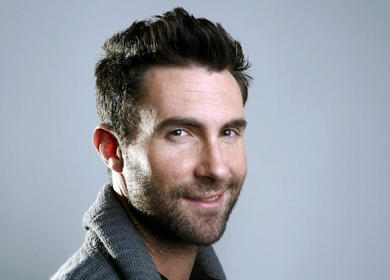 "FILE - This Feb. 20, 2012 file photo shows Maroon 5 frontman Adam Levine in New York. The musician and star of TV's ""The Voice"" is up for favorite band, song, album and music video, along with favorite celebrity judge and favorite competition TV show for the People's Choice Awards. Nominations were announced Thursday, Nov. 15, at the Paley Center for Media in Beverly Hills, Calif. Fans chose the nominees by voting online and can do the same to select the winners. Voting in 48 categories continues through Dec. 13. The People's Choice Awards will be presented Jan. 9, 2013, and broadcast on CBS. (AP Photo/Carlo Allegri, file)"