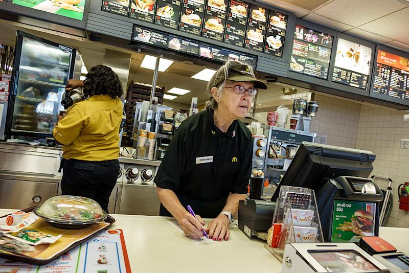 Senior woman working in McDonald's fast food restaurant