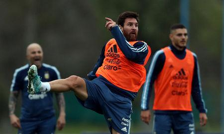 FILE PHOTO: Football Soccer - Argentina's national soccer team training - World Cup 2018 Qualifiers - Buenos Aires, Argentina - August 28, 2017 - Argentina's Lionel Messi takes part in a training session ahead of the match against Uruguay alongside team mate Mauro Icardi and head coach Jorge Sampaoli. REUTERS/Marcos Brindicci -/File Photo
