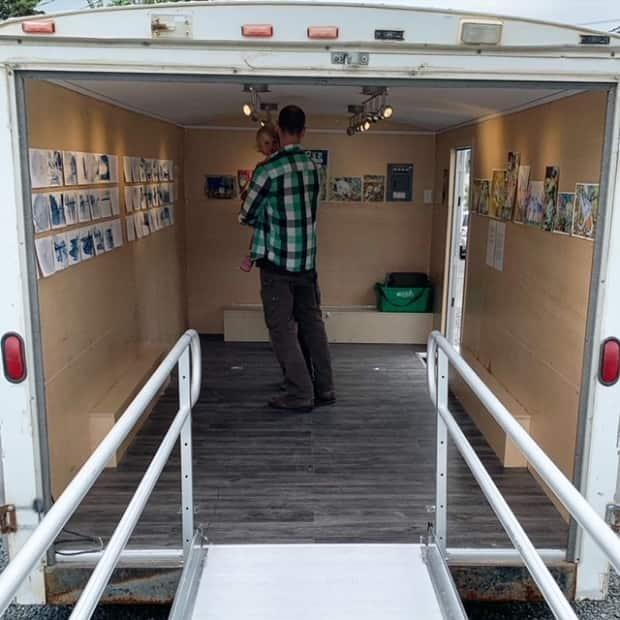 Currently, the Art Gallery of the N.W.T. operates out of a 16-by-8 foot trailer. Here, visitors take a look at exhibition by Yellowknife's Alison McCreesh and Yukon's Kim Edgar in Yellowknife last July.