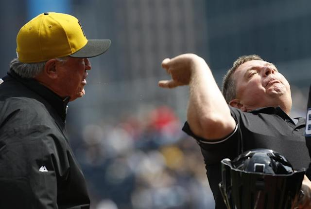 Home plate umpire Greg Gibson, right, ejects Pittsburgh Pirates manager Clint Hurdle after first base coach Rick Sofield argued a third strike call to end the fourth inning of the baseball game against the Toronto Blue Jays, Sunday, May 4, 2014, in Pittsburgh. Sofield was also ejected. (AP Photo/Keith Srakocic)