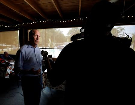 Dan Bishop, Republican candidate in the special election for North Carolina's 9th Congressional District, speaks to the media at an election day campaign stop, in Indian Trail, North Carolina