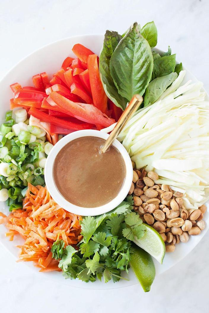 "<p>Put a healthy twist on your pad thai in this colorful mélange that's sure to become a weeknight staple. No tamarind paste? Simply leave it out ― the dressing will still taste great. </p><p><strong>Get the recipe on <a href=""http://www.loveleafco.com/pad-thai-salad/"" rel=""nofollow noopener"" target=""_blank"" data-ylk=""slk:Loveleaf Co"" class=""link rapid-noclick-resp"">Loveleaf Co</a>.</strong></p>"