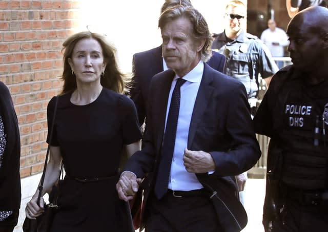 Felicity Huffman arrives at court with her husband William H Macy in Boston