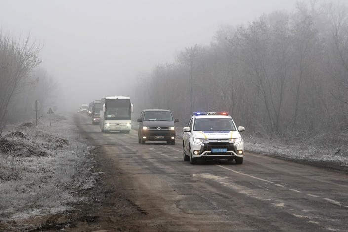 A column of buses with Russia-backed war prisoners drive to be exchanged near Odradivka, eastern Ukraine, Sunday, Dec. 29, 2019. Ukraine's president says his country expects to swap prisoners with Russia-backed separatists in the east on Sunday. (AP Photo/Evgeniy Maloletka)