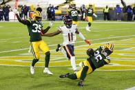 Green Bay Packers' Darnell Savage intercepts a pass in the end zone in front of Chicago Bears' Darnell Mooney during the first half of an NFL football game Sunday, Nov. 29, 2020, in Green Bay, Wis. (AP Photo/Matt Ludtke)