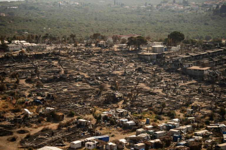 Moria, home to more than 12,000 migrants including hundreds of unaccompanies minors, was totally destroyed on September 9, 2020 after a two-day blaze (AFP/ANGELOS TZORTZINIS)