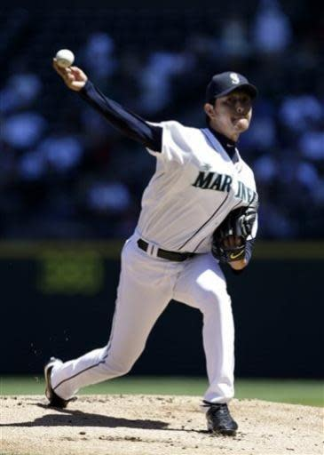 Seattle Mariners starting pitcher Hisashi Iwakuma throws against the Los Angeles Angels in the first inning of a baseball game on Sunday, July 14, 2013, in Seattle. (AP Photo/Elaine Thompson)