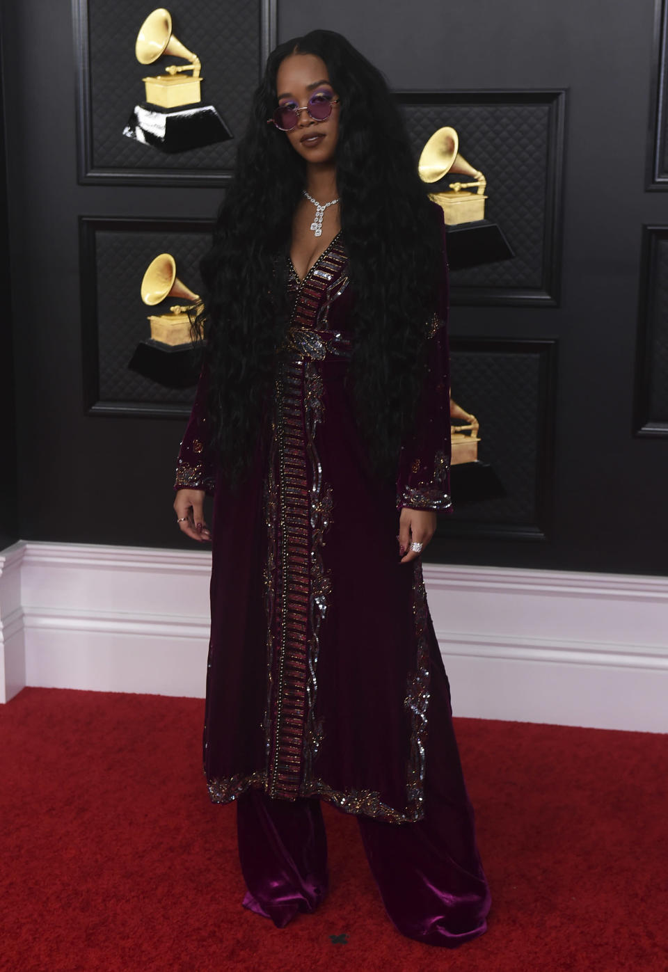 H.E.R. arrives at the 63rd annual Grammy Awards at the Los Angeles Convention Center on Sunday, March 14, 2021. (Photo by Jordan Strauss/Invision/AP)