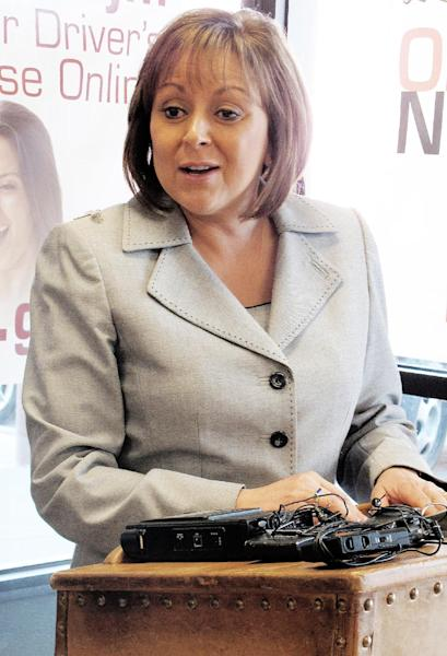 File-This Jan. 23,2013 file photo New Mexico Gov. Susana Martinez is shown at the Albuquerque Motor Vehicle Department during a news conference. Martinez and Nevada Gov. Brian Sandoval will head up a new Republican effort to recruit Hispanic and female candidates for state offices across the country. (AP Photo/Russell Contreras,File)