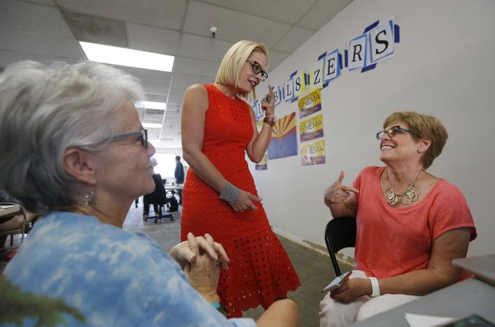 """<span class=""""s1"""">Rep. Kyrsten Sinema, D-Ariz., middle, talks to volunteers on Tuesday, primary election day, in Phoenix. (Photo: Ross D. Franklin/AP)</span>"""