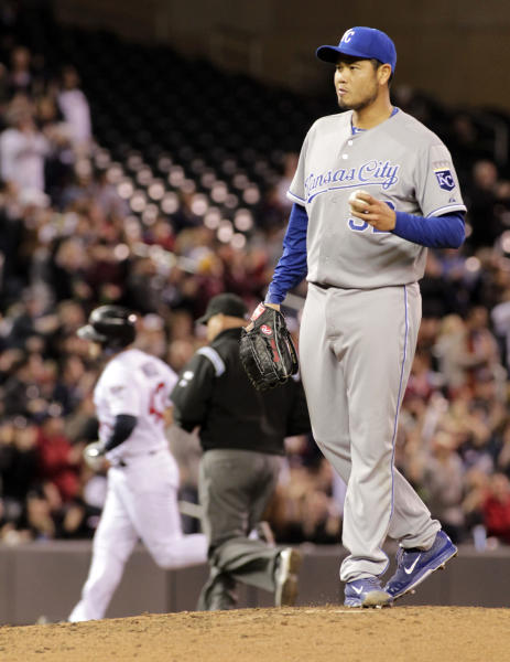 Kansas City Royals starting pitcher Bruce Chen (52) stands on the mound after giving up a solo home run to Minnesota Twins designated hitter Josmil Pinto (43), background, during the fourth inning of a baseball game, Friday, April 11, 2014, in Minneapolis. AP Photo/Paul Battaglia)