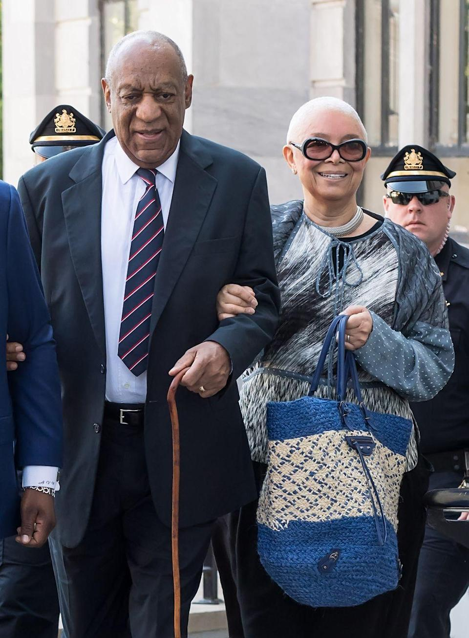 """<p>Even though her husband was convicted of rape and assault, Camille Cosby is still with him and still defending him, per <em><a href=""""https://www.nytimes.com/2018/09/17/arts/television/bill-cosby-camille-cosby-trial-judge.html"""" rel=""""nofollow noopener"""" target=""""_blank"""" data-ylk=""""slk:The New York Times"""" class=""""link rapid-noclick-resp"""">The New York Times</a></em>. </p><p>According to <em><a href=""""https://people.com/tv/bill-cosby-not-divorcing-wife-camille/"""" rel=""""nofollow noopener"""" target=""""_blank"""" data-ylk=""""slk:People"""" class=""""link rapid-noclick-resp"""">People</a></em>, the two have been married since 1964—during which time more than 60 women have come forward with accusations and proof of Bill's sexual misconduct and assault.</p>"""
