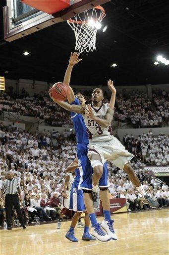 Mississippi State guard Dee Bost drives to the basket and scores as Kentucky's Anthony Davis attempts to block the shot during an NCAA college basketball game Tuesday, Feb. 21, 2012, in Starkville, Miss. (AP Photo/The Clarion-Ledger, Keith Warren) NO SALES