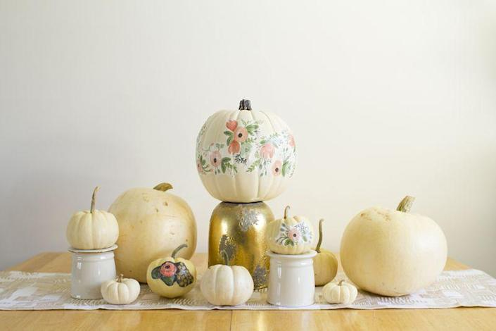 """<p>Don't want to use your own handwriting to paint a pumpkin? Grab your favorite wrapping paper and paste it on with Mod Podge. </p><p><em><strong>Get the tutorial from <a href=""""http://www.kastles.ca/2015/10/floral-pumpkins.html"""" rel=""""nofollow noopener"""" target=""""_blank"""" data-ylk=""""slk:Kastles"""" class=""""link rapid-noclick-resp"""">Kastles</a>. </strong></em></p>"""