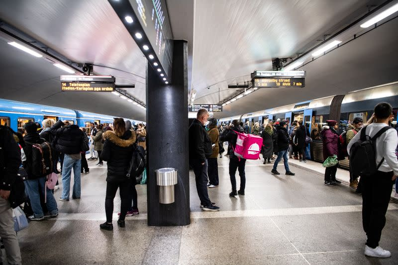 FILE PHOTO: Commuters at Stockholm Central metro station catch trains during rush hours