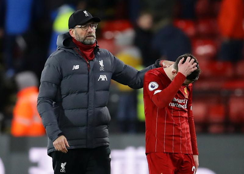 """Soccer Football - Premier League - Watford v Liverpool - Vicarage Road, Watford, Britain - February 29, 2020 Liverpool manager Juergen Klopp and Andrew Robertson look dejected at the end of the match REUTERS/David Klein EDITORIAL USE ONLY. No use with unauthorized audio, video, data, fixture lists, club/league logos or """"live"""" services. Online in-match use limited to 75 images, no video emulation. No use in betting, games or single club/league/player publications. Please contact your account representative for further details."""