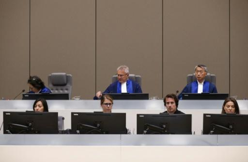 Justice: The International Criminal Court at Monday's verdict. Head judge Robert Fremr is in the centre of the back row