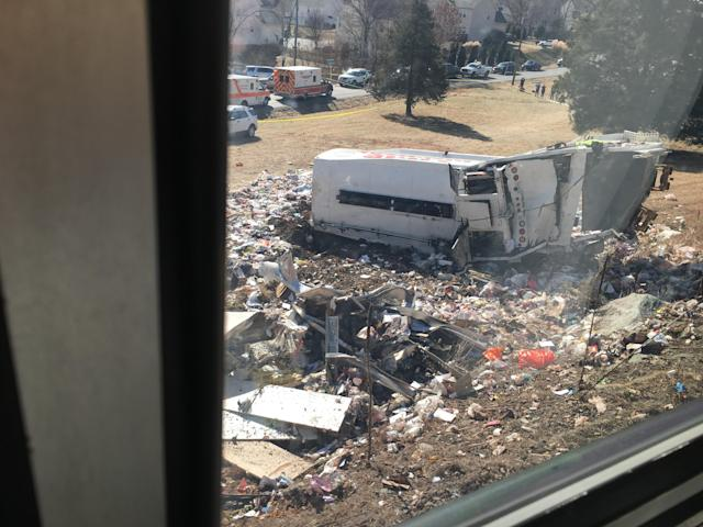 <p>This photo provided by Rep. Bruce Poliquin, R-Maine shows damage to a garbage truck after it was hit by a chartered train carrying members of Congress in Crozet, Va. on Jan. 31, 2018. (Photo: Bruce Poliquin via AP) </p>