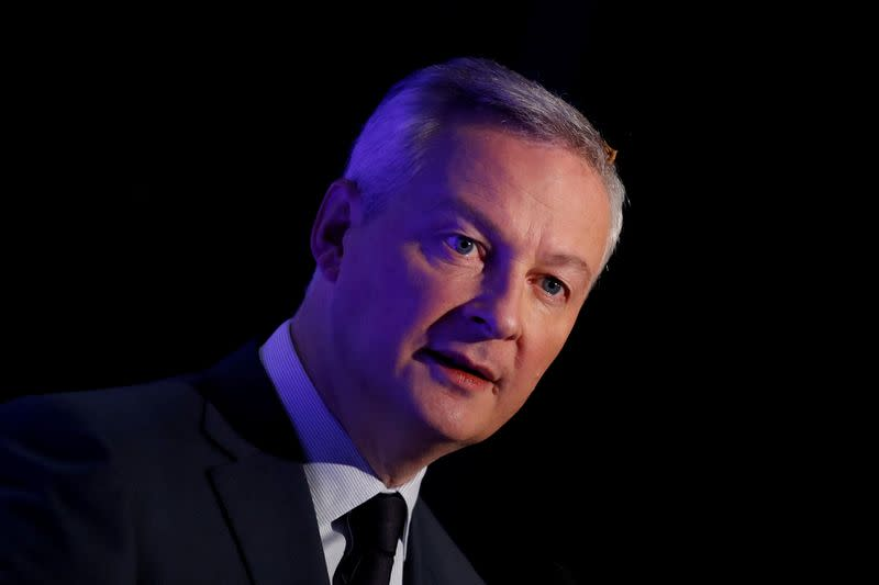 FILE PHOTO: French Finance Minister Bruno Le Maire attends a news conference in Boulogne-Billancourt