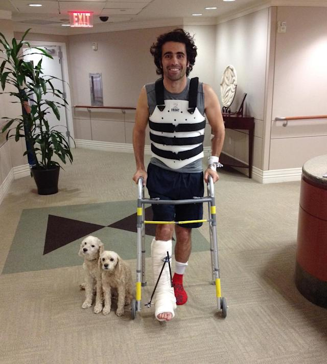 In this photo provided by Team Chip Ganassi Racing, IndyCar driver Dario Franchitti, of Scotland, poses with his dogs, Shug and Buttermilk, in a photo taken by his brother, Marino Franchitti, at Memorial Hermann-Texas Medical Center in Houston, Thursday, Oct. 10, 2013. Franchitti has been released from a Houston hospital, four days after fracturing his spine and breaking his right ankle in an IndyCar Series crash. (AP Photo/Marino Franchitti)