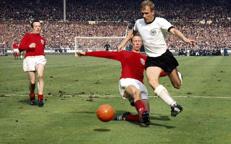 Nobby Stiles looks on as Jack Charlton makes a tackle during the England v West Germany 1966 World Cup Final at Wembley - Rex Features