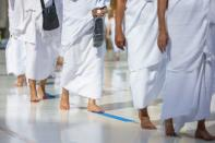 Pilgrims keeping social distance perform their Umrah at the Grand Mosque during the annual Haj pilgrimage, in the holy city of Mecca