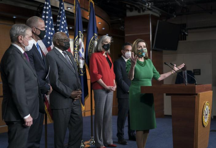 """<span class=""""caption"""">Speaker of the House Nancy Pelosi and other top Democrats meet with reporters before the House voted to pass a $1.9 trillion pandemic relief package on Feb. 26, 2021. </span> <span class=""""attribution""""><a class=""""link rapid-noclick-resp"""" href=""""https://newsroom.ap.org/detail/VirusOutbreakCongress/55e0725a5fff4da999dc8483350d1976/photo?Query=Congress%20AND%20voting&mediaType=photo&sortBy=arrivaldatetime:desc&dateRange=Anytime&totalCount=8044&currentItemNo=3"""" rel=""""nofollow noopener"""" target=""""_blank"""" data-ylk=""""slk:AP Photo/J. Scott Applewhite"""">AP Photo/J. Scott Applewhite</a></span>"""