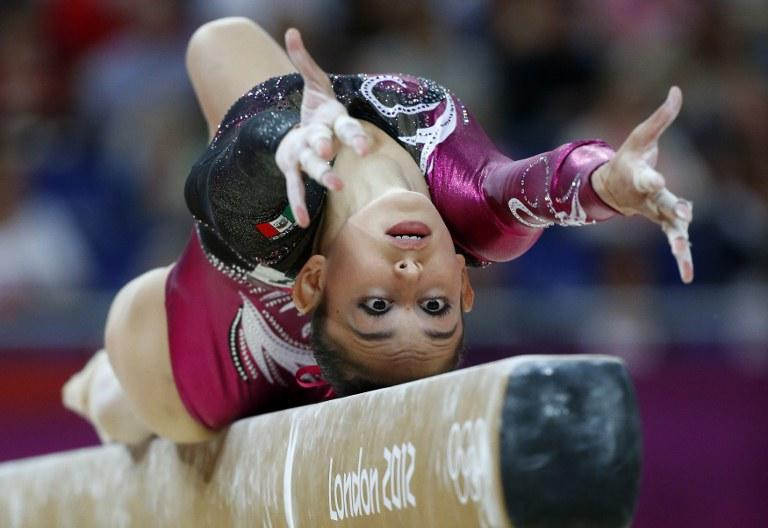 Mexico's gymnast Elsa Garcia Rodriguez Blancas performs on the beam during the women's qualification of the artistic gymnastics event of the London Olympic Games on July 29, 2012 at the 02 North Greenwich Arena in London. AFP PHOTO / THOMAS COEX