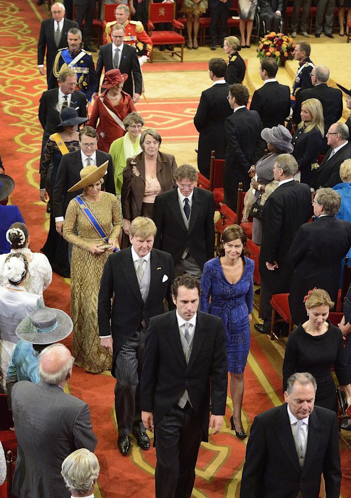 """Netherlands' King Willem-Alexander, third row left, and his wife Queen Maxima, fourth row left, arrive for the opening of the new parliamentary year with a speech outlining the government's plan and budget policies for the year ahead, at the 13th century """"Hall of Knights"""" in The Hague, Netherlands, Tuesday, Sept. 17, 2013. (AP Photo/Lex van Lieshout, Pool)"""