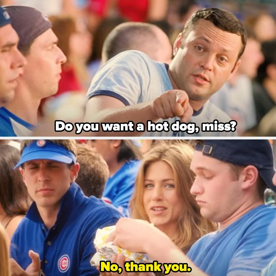 Gary offering Brooke a hot dog at a Chicago Cubs baseball game
