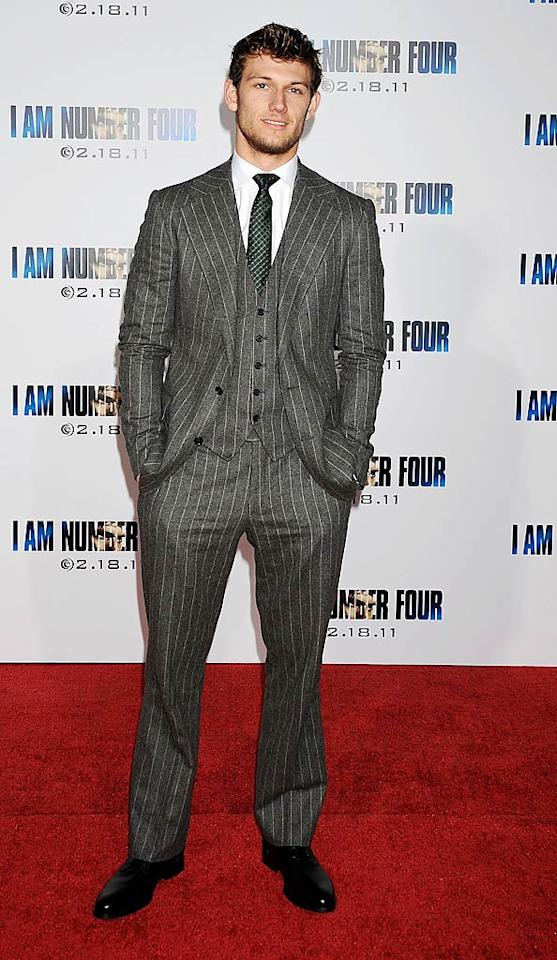 "Speaking of English eye candy, Alex Pettyfer attended the highly anticipated Los Angeles premiere of his new action flick, ""I Am Number Four,"" in a chic, three-piece, pin-striped suit and a dash of scruff. Jeffrey Mayer/<a href=""http://www.wireimage.com"" target=""new"">WireImage.com</a> - February 9, 2011"