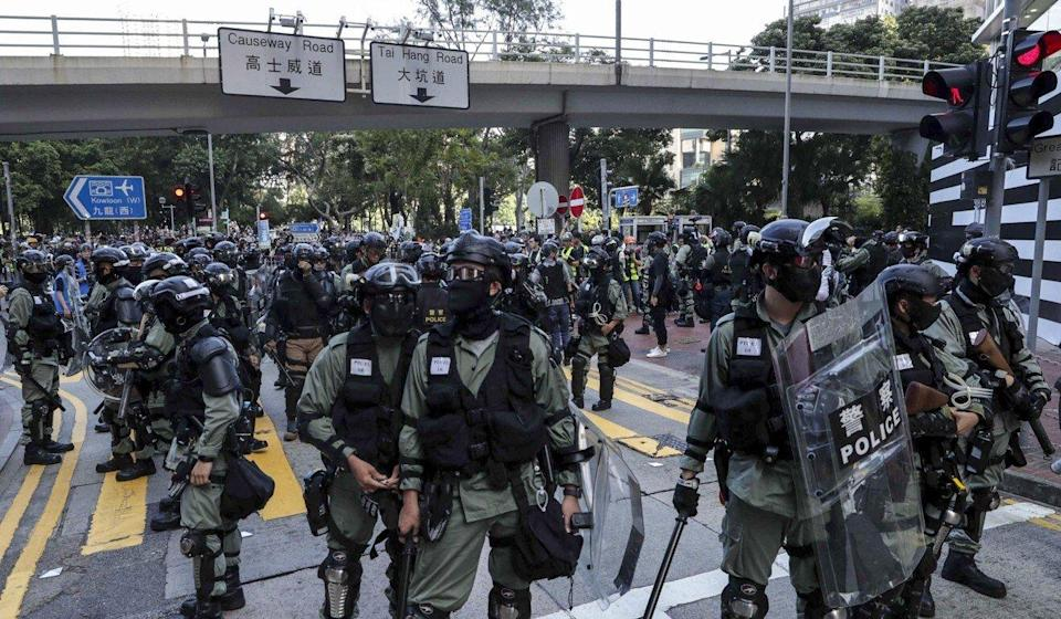 Officers from the Police Tactical Unit will be on standby should any trouble occur. Photo: Edmond So