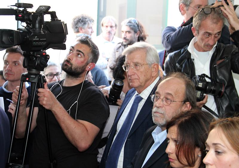"""Defendants Claudio Eva, center, and Bernardo De Bernardinis, third from right, a former official of the national Civil Protection agency, listen to the verdict at L'Aquila court, Italy, Monday, Oct. 22, 2012. An Italian court has convicted seven scientists and experts of manslaughter for failing to adequately warn citizens before an earthquake struck central Italy in 2009, killing more than 300 people. The court in L'Aquila Monday evening handed down the convictions and six-year-prison sentences to the defendants, members of a national """"Great Risks Commission."""" In Italy, convictions aren't definitive until after at least one level of appeals, so it is unlikely any of the defendants would face jail immediately. Scientists worldwide had decried the trial as ridiculous, contending that science has no way to predict quakes. (AP Photo/Raniero Pizzi)"""