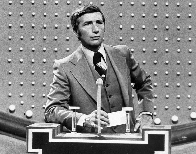 """FILE - This June 1978 file photo shows Richard Dawson, host of """"Family Feud"""" in character. Dawson, the wisecracking British entertainer who was among the schemers in the 1960s sitcom """"Hogan's Heroes"""" and a decade later began kissing thousands of female contestants as host of the game show """"Family Feud"""" died Saturday, June 2, 2012. He was 79. (AP Photo, File)"""