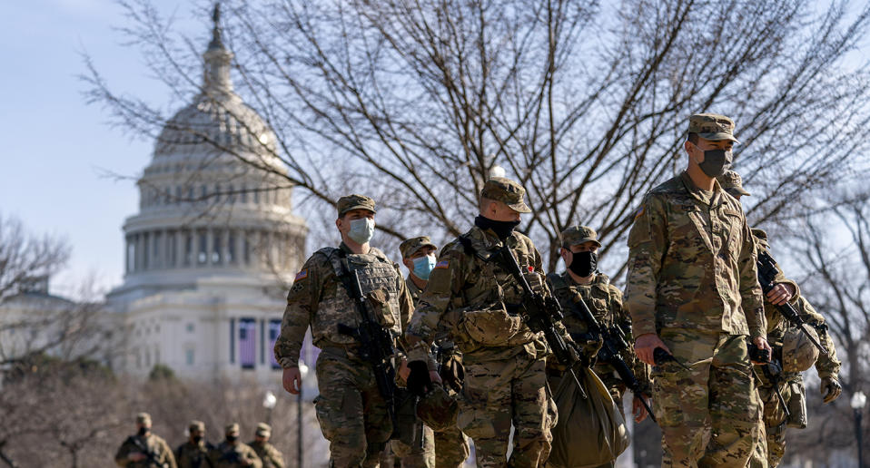 Armed soldiers seen on Washington streets as security is increased ahead of the inauguration. Source: AP