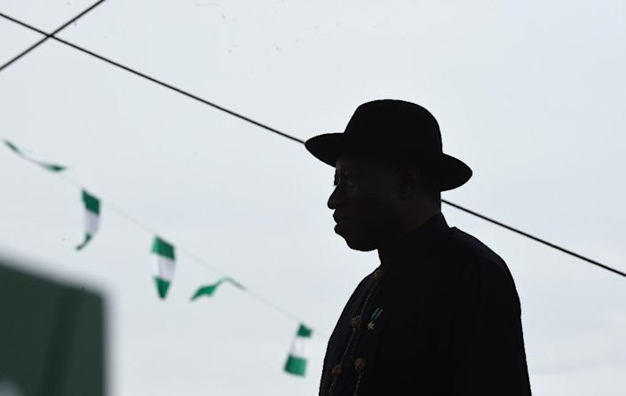 Former Nigerian president Goodluck Jonathan participates in the inauguration ceremony for his successor, Muhammadu Buhari, in Abuja on May 29, 2015 (AFP Photo/Susan Walsh)