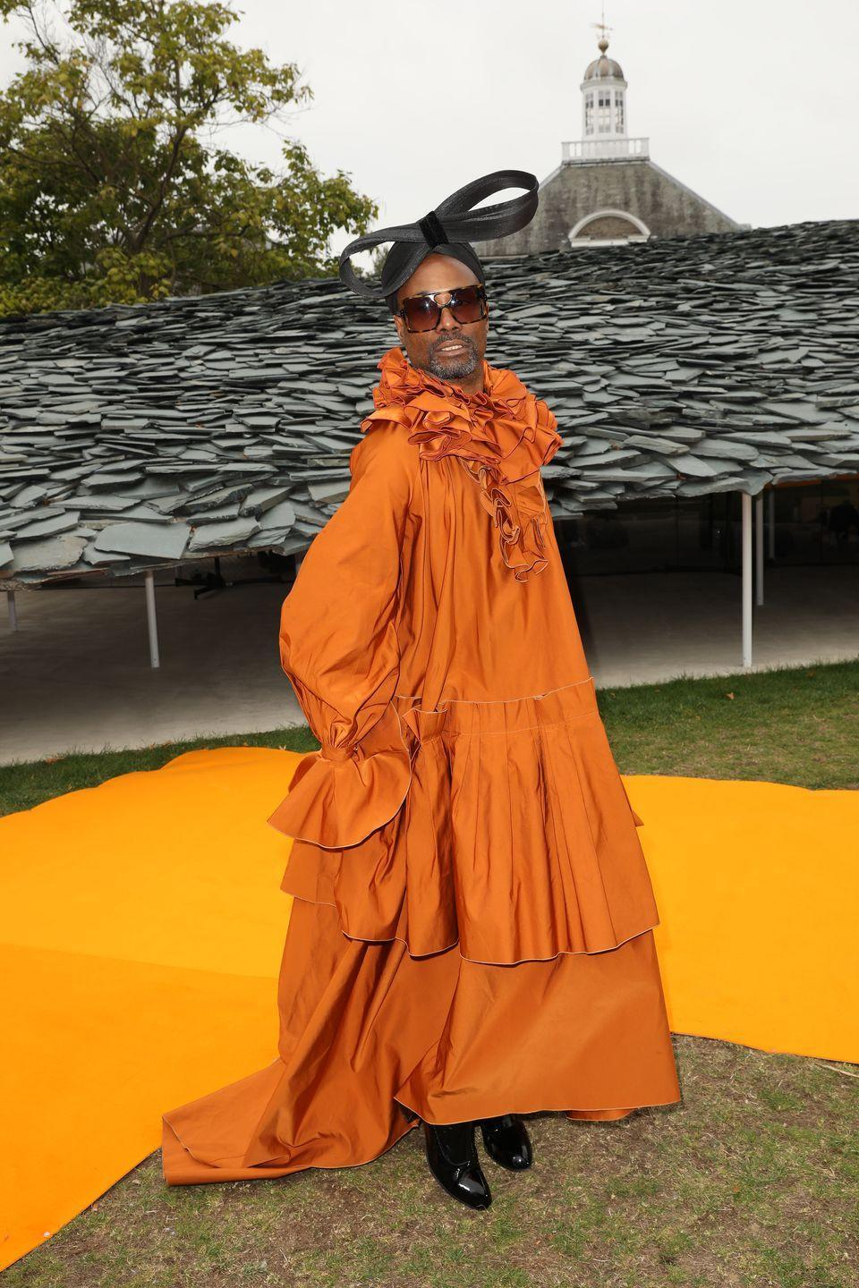 """<p>Porter's many looks dominated <a href=""""https://www.elle.com/uk/fashion/celebrity-style/a29053514/billy-porter-london-fashion-week/"""" rel=""""nofollow noopener"""" target=""""_blank"""" data-ylk=""""slk:London Fashion Week"""" class=""""link rapid-noclick-resp"""">London Fashion Week</a>, during which he made 15 outfit changes in under 72 hours, and had 20 looks in total over the four days. </p><p>To sit FROW at the Roksanda SS20 show, the actor wore a voluminous orange-coloured gown by Roksanda with black boots. He teamed the look with a black bow hat by Sarah Sokol and black shades by The Smith Society. </p><p>Porter later took to <a href=""""https://www.instagram.com/p/B2kWmhoFjdo/"""" rel=""""nofollow noopener"""" target=""""_blank"""" data-ylk=""""slk:Instagram"""" class=""""link rapid-noclick-resp"""">Instagram</a> to say that he 'immediately started crying' when the runway show began as it was 'simply beautiful'. </p>"""