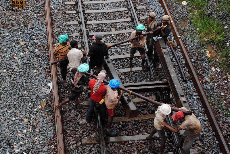 Men at work at Londa Junction. Many hands make light of heavy work. These are the muscles that run Indian Railways.