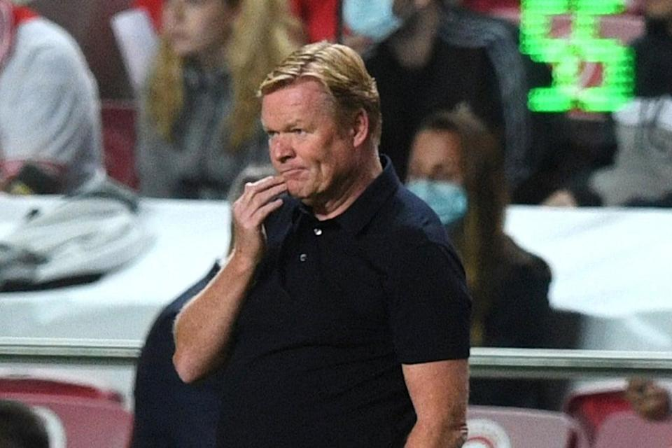 Ronald Koeman may be on the brink at Barcelona after a 3-0 loss against Benfica  (AFP via Getty Images)