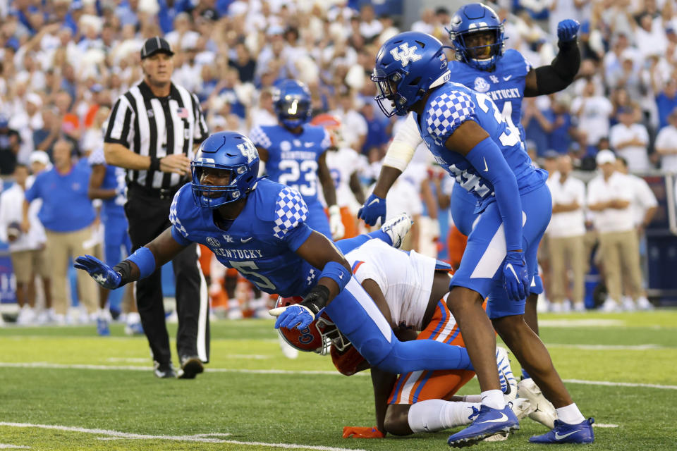 Kentucky linebacker DeAndre Square (5) dives through a tackle during the first half of an NCAA college football game against Florida in Lexington, Ky., Saturday, Oct. 2, 2021. (AP Photo/Michael Clubb)