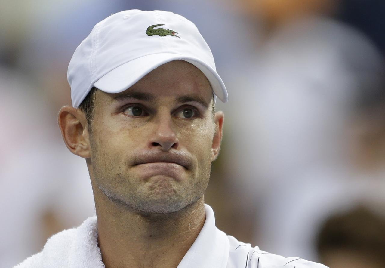 Andy Roddick reacts after losing to Juan Martin Del Potro in the quarterfinals during the 2012 US Open tennis tournament, Wednesday, Sept. 5, 2012, in New York. Roddick said he would retire after the match. (AP Photo/Darron Cummings)