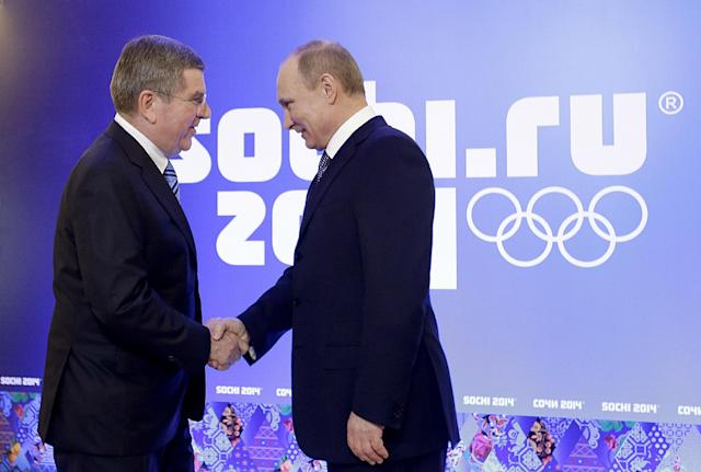 Russian President Vladimir Putin, right, greets International Olympic Committee President Thomas Bach at an event welcoming IOC members ahead of the upcoming 2014 Winter Olympics at the Rus Hotel, Tuesday, Feb. 4, 2014, in Sochi, Russia. (AP Photo/David Goldman, Pool)