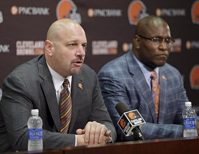 Cleveland Browns head coach Mike Pettine, left, and general manager Ray Farmer talks about the 2014 draft at the NFL football team's facility in Berea, Ohio, Friday, May 9, 2014. After a series of trades, the Browns selected Oklahoma State cornerback Justin Gilbert with the eighth overall pick and Texas A&M quarterback Johnny Manziel with the 22nd. (AP Photo/Mark Duncan)
