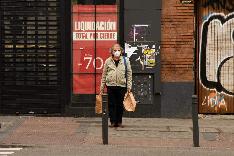 People wear masks as a precaution against the coronavirus (Covid-19) in Madrid on March 18, 2020. (Photo by Juan Carlos Lucas/NurPhoto via Getty Images)