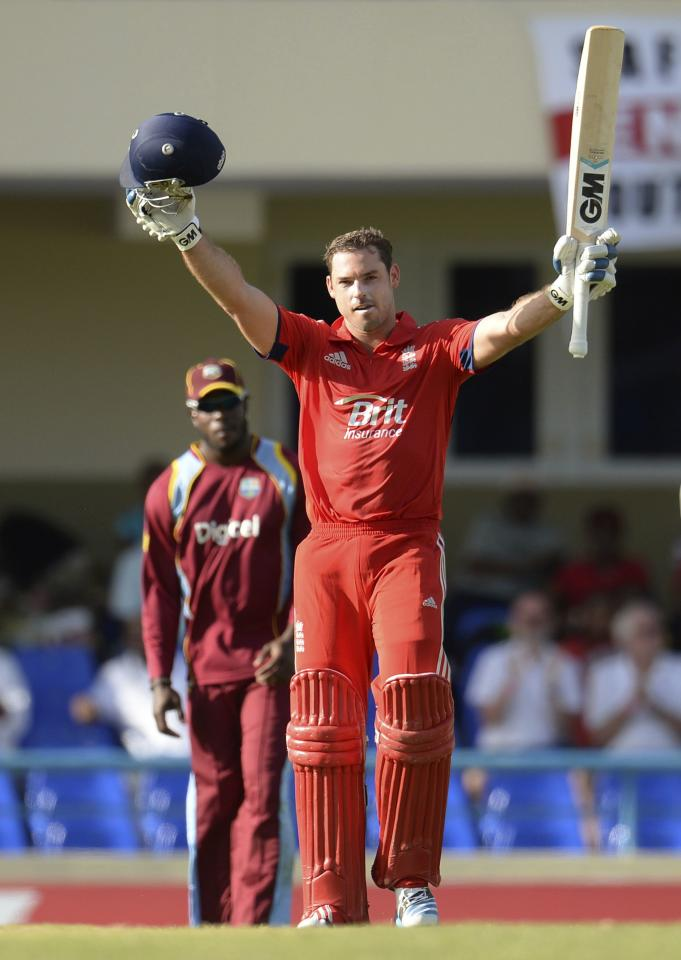 England's Michael Lumb's celebrates reaching his century during the first One-Day International against the West Indies at North Sound in Antigua February 28, 2014. REUTERS/Philip Brown (ANTIGUA - Tags: SPORT CRICKET)