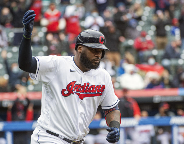Cleveland Indians' Franmil Reyes reacts after hitting a three-run home run off New York Yankees starting pitcher Jameson Taillon during the fourth inning of a baseball game in Cleveland, Sunday, April 25, 2021. (AP Photo/Phil Long)