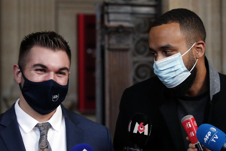 Alek Skarlatos, left, and Anthony Sadler, right, deliver a speech during the Thalys attack trial at the Paris courthouse, Friday, Nov. 20, 2020. Passengers who wrestled and disarmed an Islamic State gunman aboard a high-speed Amsterdam to Paris train are recounting how their split-second decisions helped prevent what could have become a mass slaughter. (AP Photo/Francois Mori)