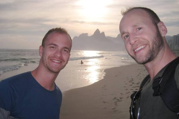 Hopeful parents Lucas de Flavia, left, and Jonathan Hobin, right, are pictured here in de Flavia's native country of Brazil in 2014. (Submitted by Jonathan Hobin - image credit)